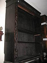 Early 20th Century oak open bookcase with a carved frieze