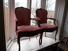 Pair of 20th Century French mahogany and upholstered open elbow chairs in Louis XV style