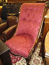 19th Century rosewood button upholstered nursing chair having red damask upholstery raised on carved cabriole front supports on brass caps and casters