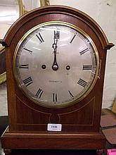 Edwardian mahogany and line inlaid bracket clock, the broken arch case with circular silvered dial and Roman numerals, signed Lewis, Chichester, the two train movement striking and chiming on gongs