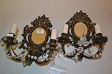 Pair of 19th Century embossed brass and mirror backed twin light wall sconces with glass mounts and drops (adapted for use with electricity)