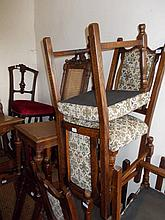 Set of six (four plus two) reproduction oak dining chairs with padded backs and seats