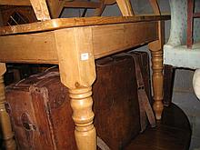 Rectangular polished pine kitchen table on turned supports