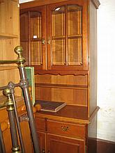 Reproduction cherry wood display cabinet with a pair of glazed doors above two drawers and two doors below