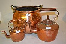 19th Century circular copper cauldron with iron handle together with two copper kettles