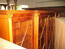 Reproduction yew wood breakfront bookcase, the moulded dentil cornice above four astragal glazed doors divided by fluted pilasters above four drawers and four further panelled doors