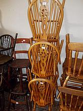 Set of six reproduction beechwood wheel and stick back dining chairs, together with a small pine refectory style dining table
