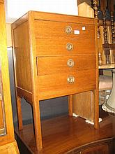 20th Century oak music cabinet, the drawers with fall fronts raised on square tapering supports
