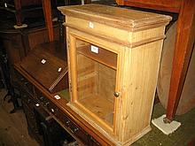 Small pine wall cupboard with glazed panel door
