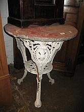 Circular white painted metal garden table