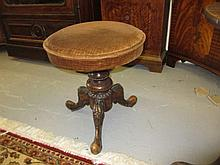 Victorian carved walnut piano stool with revolving seat on tripod base