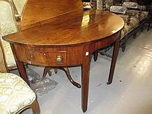 George III mahogany half round side table, the plain top above a shaped frieze incorporating two drawers raised on square cut chamfered supports
