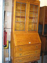 Light oak bureau bookcase circa 1930 with two glazed doors above a fall front and drawers on baluster supports