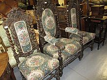 Set of three (one plus two) 19th Century carved oak dining chairs with padded backs and grape vine carved decoration, overstuffed seats raised on barley twist supports united by matching stretchers