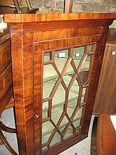 George III mahogany hanging corner cabinet with a single astragal glazed door