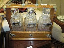Late Victorian brass mounted three bottle tantalus