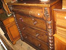 Victorian mahogany chest with a concealed frieze drawer above three further drawers flanked by barley twist columns
