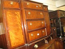 Reproduction mahogany breakfront dwarf side cabinet with four centre drawers flanked by two further drawers with cupboard doors below