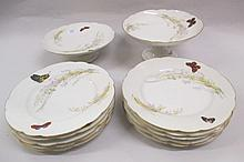 Limoges dessert service decorated with flowers and butterflies (some damages)