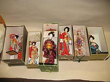 Group of six Japanese Geisha dolls in original boxes
