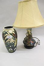 20th Century Moorcroft floral decorated lamp base together with a late Moorcroft baluster form vase decorated with bulrushes and lilies (crack and chip to rim)