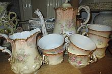 Limoges floral and gilt decorated tea service comprising:  cups, saucers, teapot, sugar bowl, hot water pot etc.