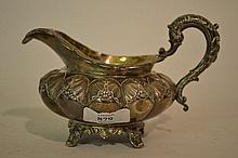 Victorian silver cream jug of fluted and floral embossed design