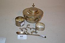 Late Victorian circular silver inkwell (a/f), two silver napkin rings and a spoon