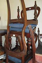 Set of six Victorian mahogany balloon back dining chairs with drop-in seats, raised on turned tapering supports, together with a pair of similar balloon back chairs