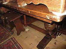 Reproduction rectangular oak refectory style dining table raised on carved baluster end supports with stretcher
