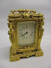Ornate gilt metal cased carriage clock with enamel dial, Arabic and Roman numerals and single train movement