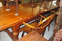 Large 20th Century yew wood refectory style dining table, the plank top above four baluster turned supports united by an H-stretcher, 102ins long x 36ins wide