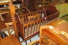 19th Century mahogany cradle on turned end supports with a turned stretcher