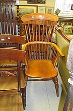 19th Century beech and elm comb back Windsor chair with panel seat and turned supports with stretchers