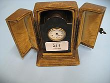 Small tortoiseshell cased travel clock with leather outer case