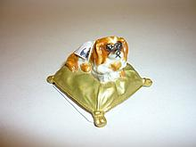 Small Royal Worcester figure of a King Charles spaniel seated on a cushion