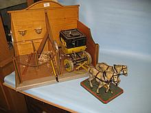 Wooden model stable together with a wooden carriage and a pair of wooden horses