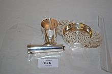 Silver tea strainer on stand, silver cheroot holder case and a silver toothpick holder