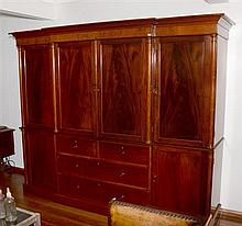 A Victorian Breakfront Wardrobe of exceptional quality with two central doors revealing five drawers H214 x w262 x D20cm