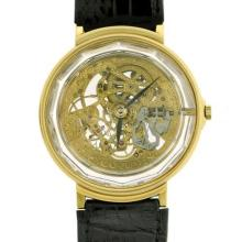 A GENT'S CORUM 18CT GOLD PRISME SKELETON WRISTWATCH; from the estate of the late Rene Rivkin, ref. 266.111.56 with manual gold movem...