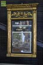 Regency Black & Gilt Overmantle Mirror, with ball frieze (one missing), lion and oak branch panel & flanked by Gothic columns. 69 x...