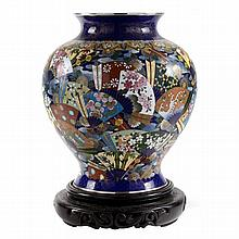 A Japanese cloisonné baluster vase decorated with fans, marked to base for Inata, with associated timber stand.