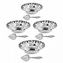 A cased set of four small silver dishes with pierced floral scrollwork, C.S.G & Co., Birmingham, date 1907/8. Length: 10.5cm. Retail...