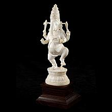 An Indian ivory figure of Ganesh on timber stand.
