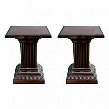 A pair of carved and walnut veneered fluted pedestals with square tops.