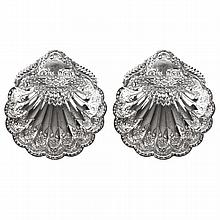 A Pair of Edwardian silver pierced and embossed bon bon dishes of shell form raised on three ball feet, H W Atkin, Sheffield 1901.