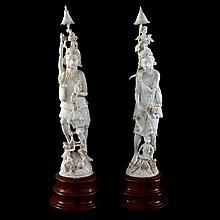 A pair of carved Indian ivory figures of bearded men with performing monkeys raised on rosewood socles.