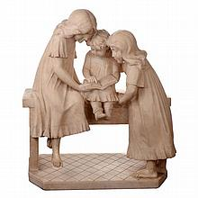 A large early C20th carved alabaster group of children reading.