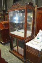 A Good Regency Rosewood and Brass Inlaid Display Cabinet with scrolled top, two glass panel doors below and flanked by columns