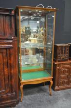 An Edwardian Maple Shop Display Cabinet, with adjustable shelves, mirror back on cabriole legs